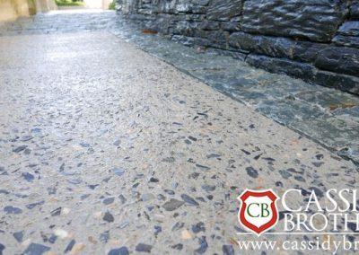Exposed Concrete Floor with Blue Gravel