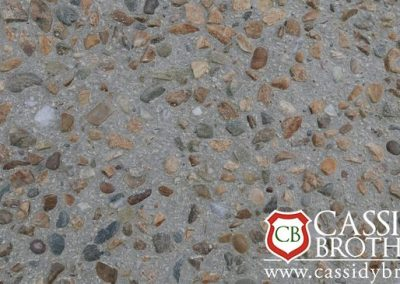 Exposed Off white Concrete Floor With Riverbed Gravel